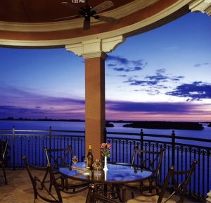 Dining along the balcony at The Bay Club in The Colony at Pelican Landing