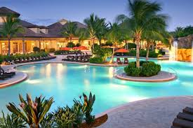 The rosort style swimming pool at The Player's Club is one of many ammenities available to thise who live in Lely Resort; a community locared in South Naples.